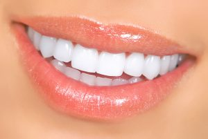 Smiling woman mouth with great teeth. Close up